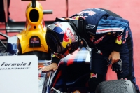 Sebastian Vettel takes care of his RB5 after scoring his second win of the season, at Silverstone