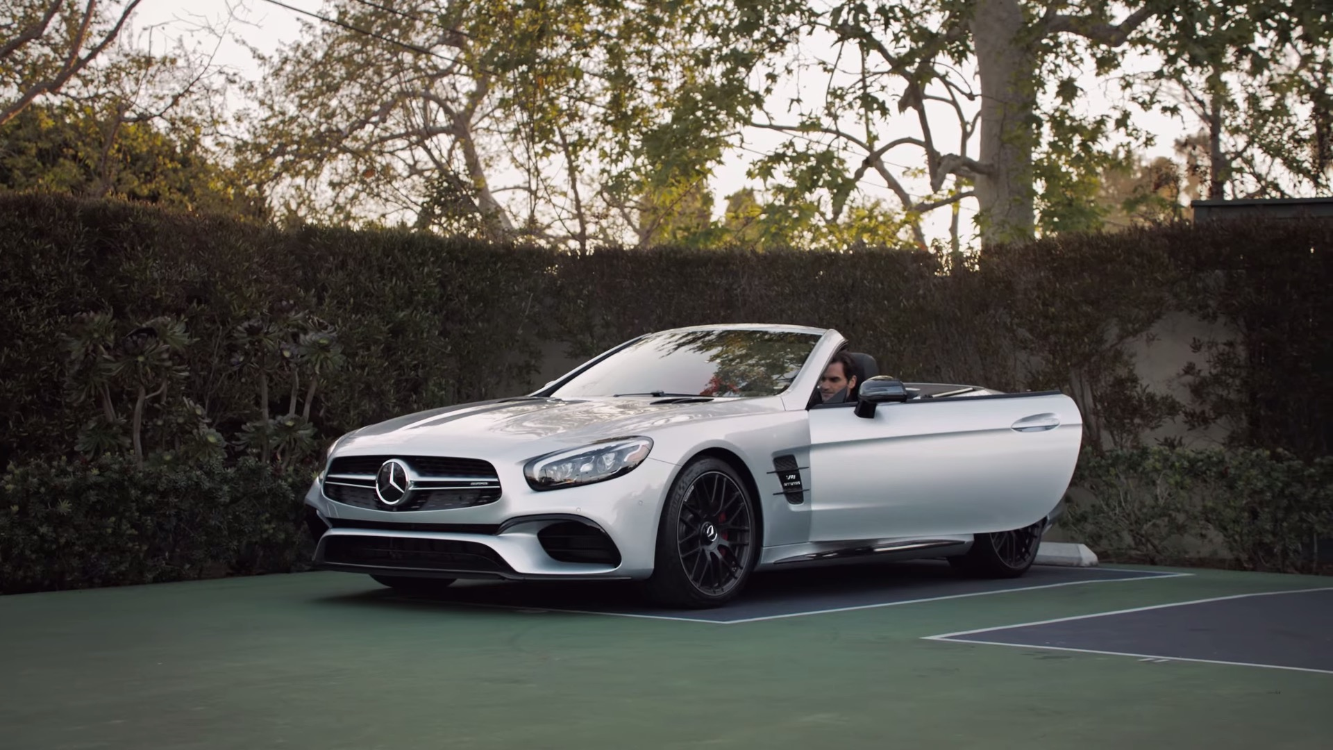 roger federer endorses 2017 mercedes benz sl in weird