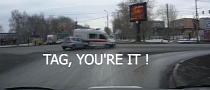 Russian Ambulance Gets Tackled in Intersection [Video]