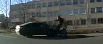 Russian Driver Cuts Rider Off, Somersault Not Exactly Perfect [Video]
