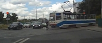 Russian Jogger Gets Poked by Tram [Video]