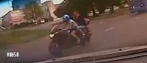 Russian Police Cruiser in Pursuit of Biker [Video]