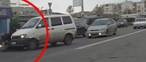 Russian Road Rage: Van Driver Crashes into Motorcycle [Video]