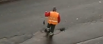 Russian Road Workers Show Us How Not to Patch Up Potholes [Video]