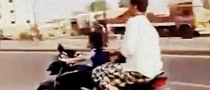Safety and Law Fail: 4-Year Riding a Motorbike in Traffic [Video]