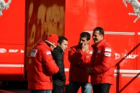 Michael Schumacher, having a chat with test drivers Luca Badoer and Marc Gene and Massa's manager Nicolas Todt