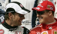 Michael Schumacher (Ferrari) and Jenson Button (BAR/Honda)