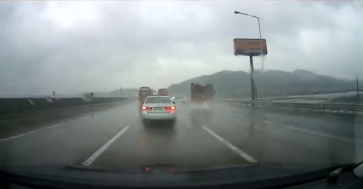 Sedan Crashes Into Truck, Sending It Off a Bridge [Video]