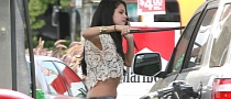 Selena Gomez Removing Bugs From Her Windscreen at Gas Station