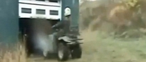 Silly ATV Rider Slams Very Hard into Garage Door [Video]