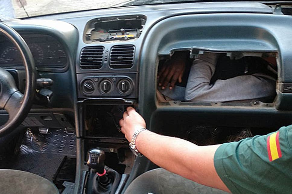 Migrant found hiding in vehicle's glove box by border police