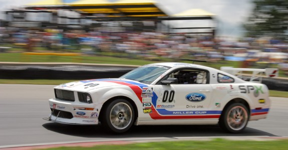 Spx to donate autographed ford mustang race car for Ford motor company service department