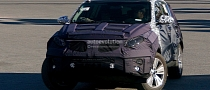 Spyshots: 2014 Kia Sportage Facelift Gets Revised Interior
