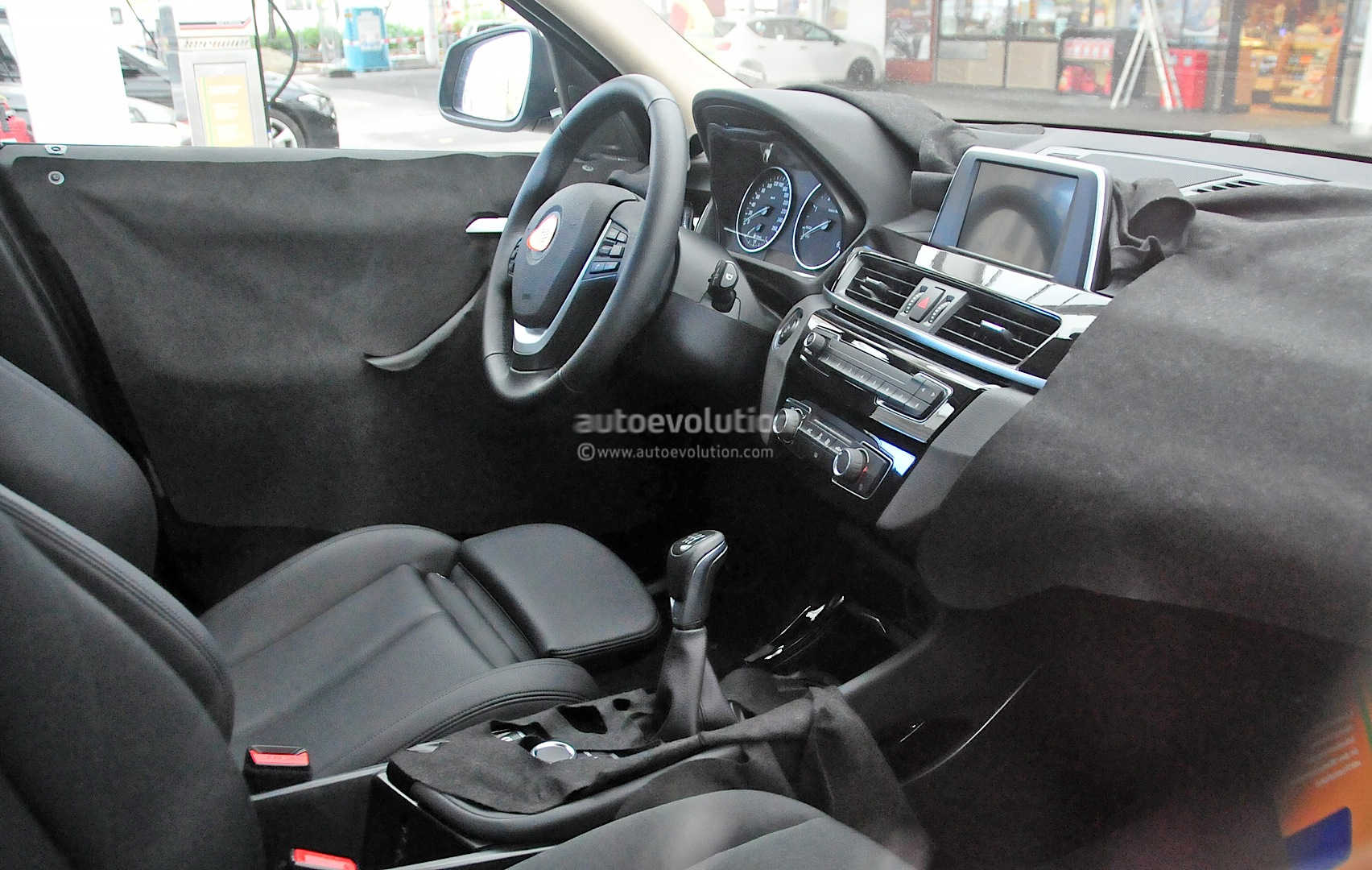 2016 bmw x1 interior revealed in spy photos autoevolution. Black Bedroom Furniture Sets. Home Design Ideas