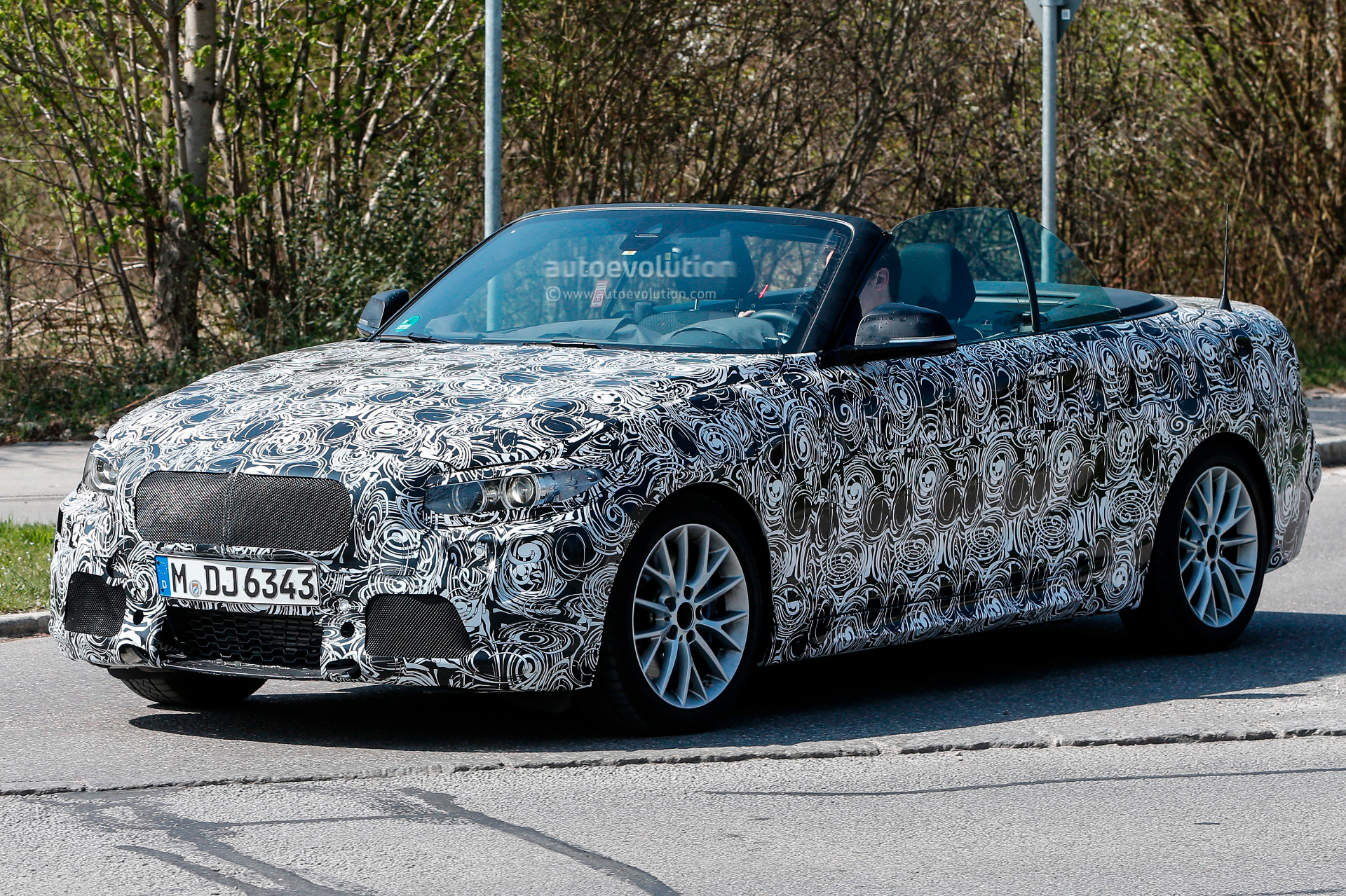 spyshots bmw m235i cabrio caught with its top down. Black Bedroom Furniture Sets. Home Design Ideas