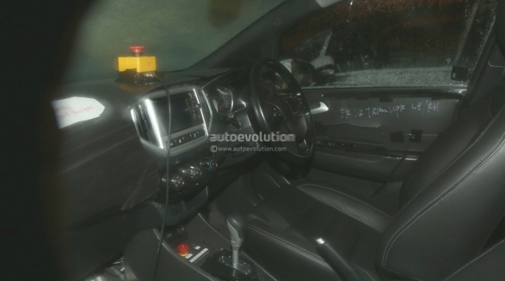 spyshots proton global small car interior photos autoevolution. Black Bedroom Furniture Sets. Home Design Ideas