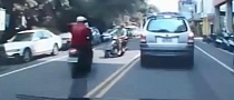 Stupid Scooter Rider Crosses Double Yellow, Crashes Hard [Video]