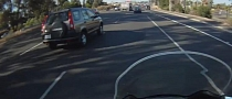 SUV Driver Almost Crashing into Biker [Video]