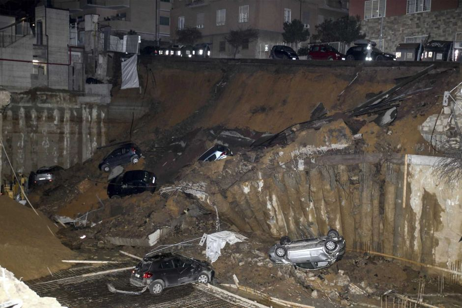 Huge sinkhole swallows cars and forces families to evacuate homes in Rome class=
