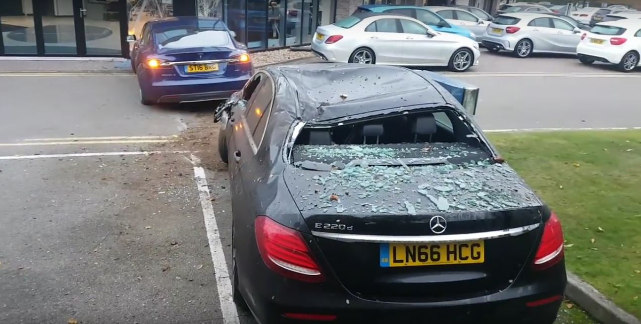 Update tesla model s has airborne crash in uk flies into for Mercedes benz dealership indianapolis