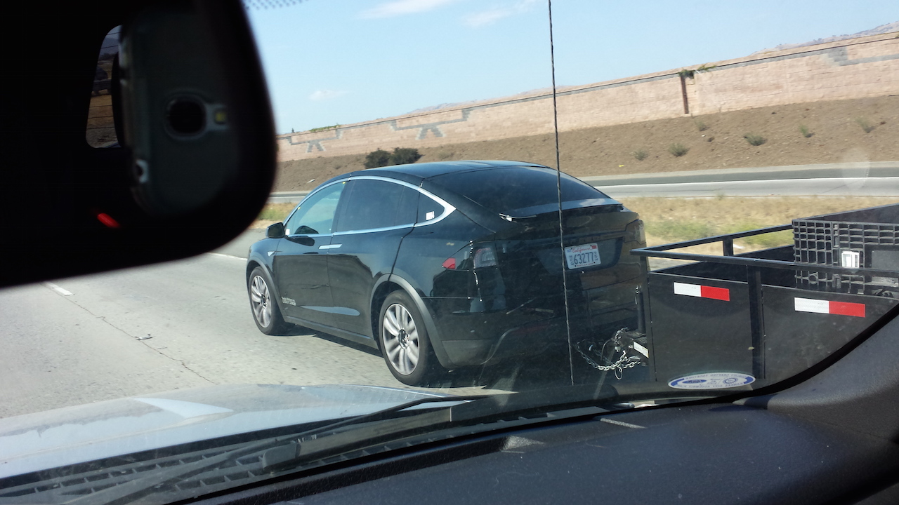 tesla model x spotted while towing a dump trailer testing 10 000 lbs towing capacity. Black Bedroom Furniture Sets. Home Design Ideas
