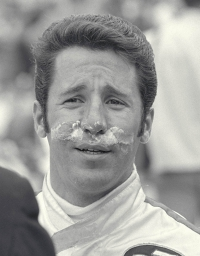 Mario Andretti takes first and only win of the Andrettis in the Indy 500, in 1969. He celebrated it with the classic bottle of milk, tradition in the Indy 500 victory lane