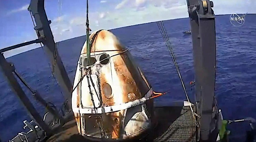 SpaceX Crew Dragon capsule splashes down into the Atlantic marking first success