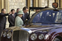 Queen Elizabeth II and one of her Bentleys