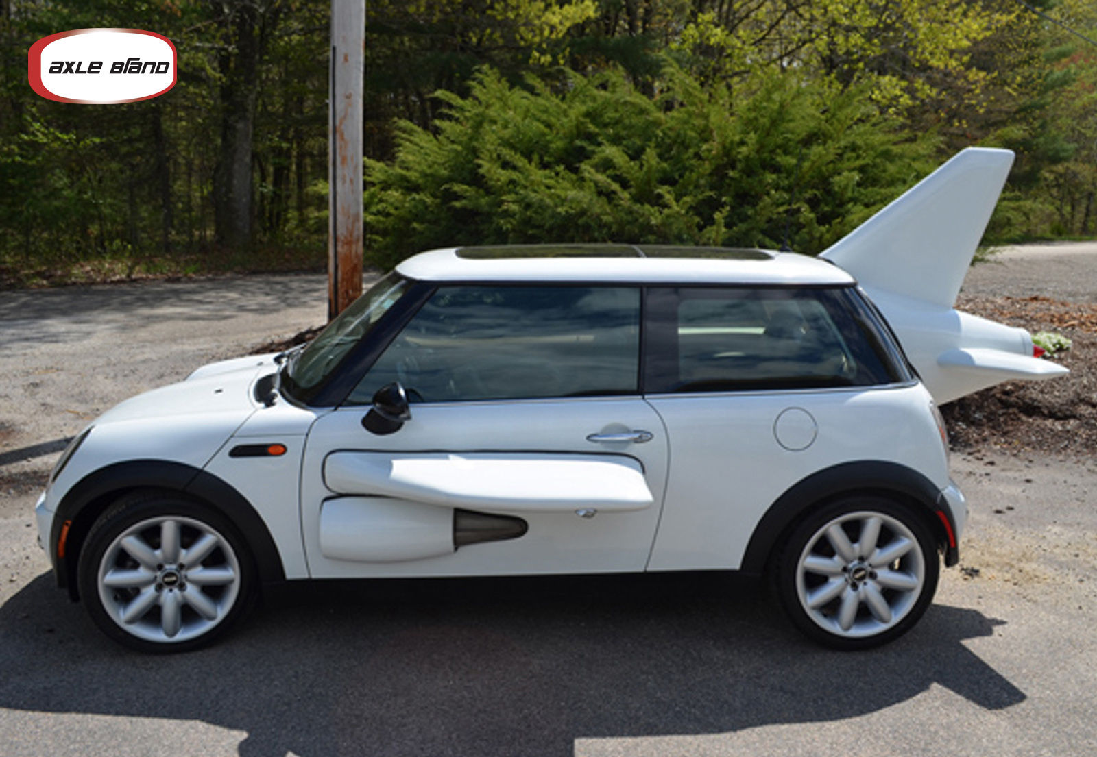 6 Photos Airplane Shaped Mini Cooper
