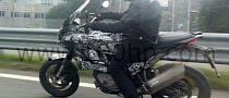 Touring Husqvarna Nuda Spy Photo Surfaces