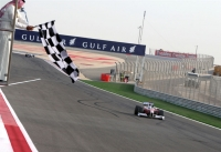 Jarno Trulli has to settle for 3rd place at the Bahrain chequered flag