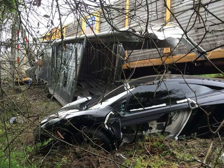 Train Wrecks Mclaren Mp4 12c Stuck On The Tracks Inside