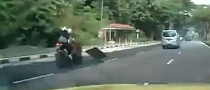 Trash On the Road Causes Very Bad Motorcycle Crash [Video]