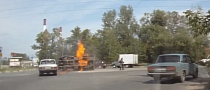 Truck Catches Fire After Russian Intersection Crash [Video]