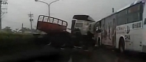 Truck Causes Massive High Speed Crash on Wet Road [Video]