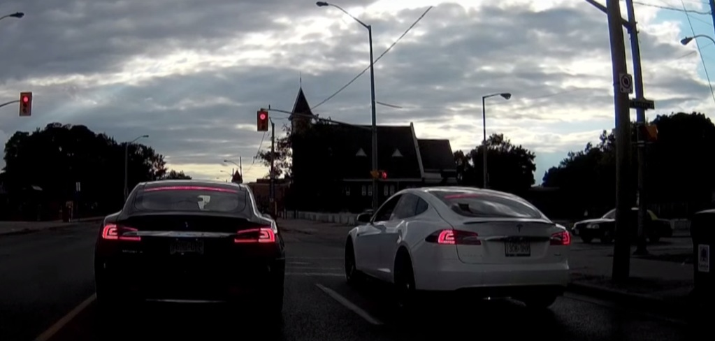tesla model s races another tesla model s from the lights but is it illegal. Black Bedroom Furniture Sets. Home Design Ideas