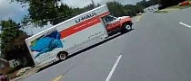 UHaul Truck versus Aware Biker [Video]