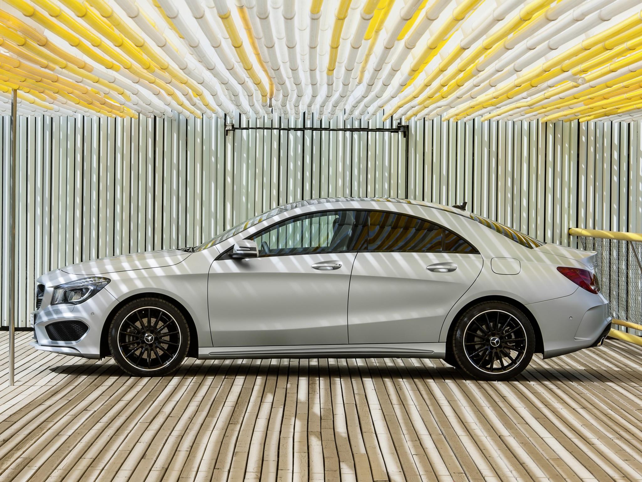 volkswagen nmc concept vs mercedes-benz cla: four-door coupe photo