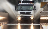 Volvo FMX in water and mud dip test