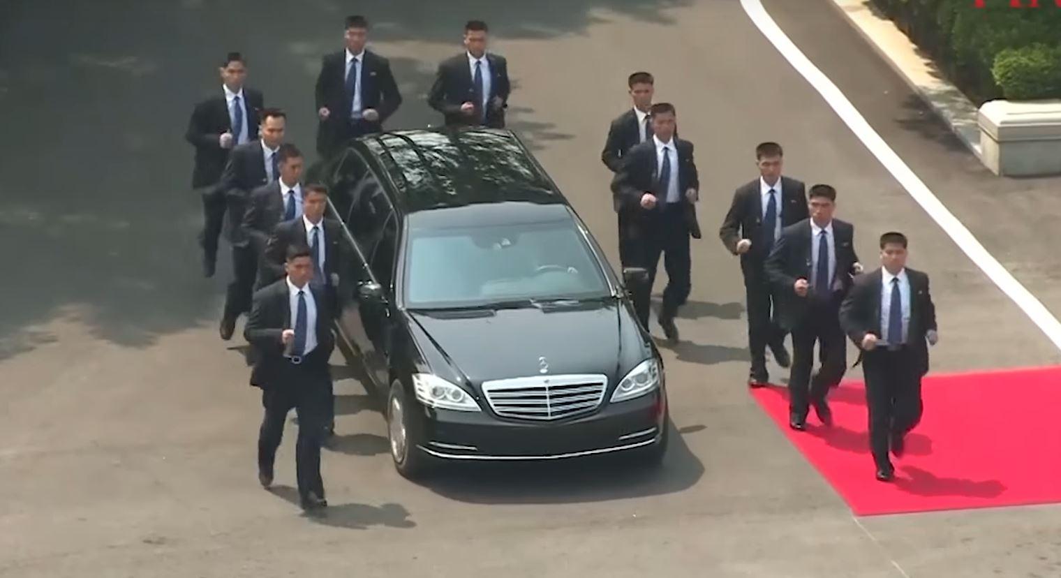 watch 12 bodyguards run alongside kim jong-un's mercedes limo