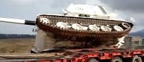 Watch a Top-Heavy UN Tank Crash [Video]