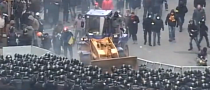 Watch Ukrainian Protesters Use a Bulldozer Against Police [Video]