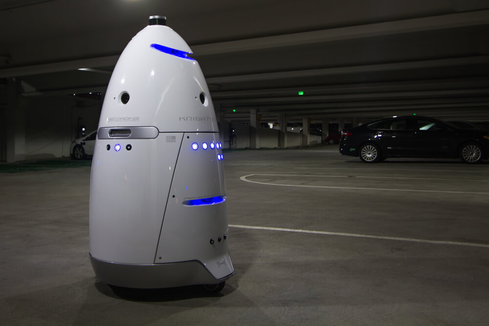 Man arrested after punching security robot