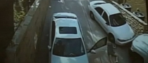 Woman Forgets Parking Brake on Sloped Surface - Gets Face-full of E-Class [Video]