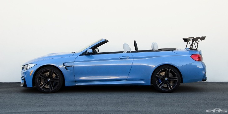 Yas Marina Blue Bmw M4 Convertible Has A Huge Trunk Wing To Boast With Autoevolution