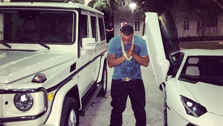 Yo Gotti Poses Next To All White Lamborghini And G Wagon
