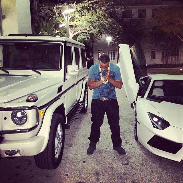Yo Gotti Poses Next To All White Lamborghini And G Wagon