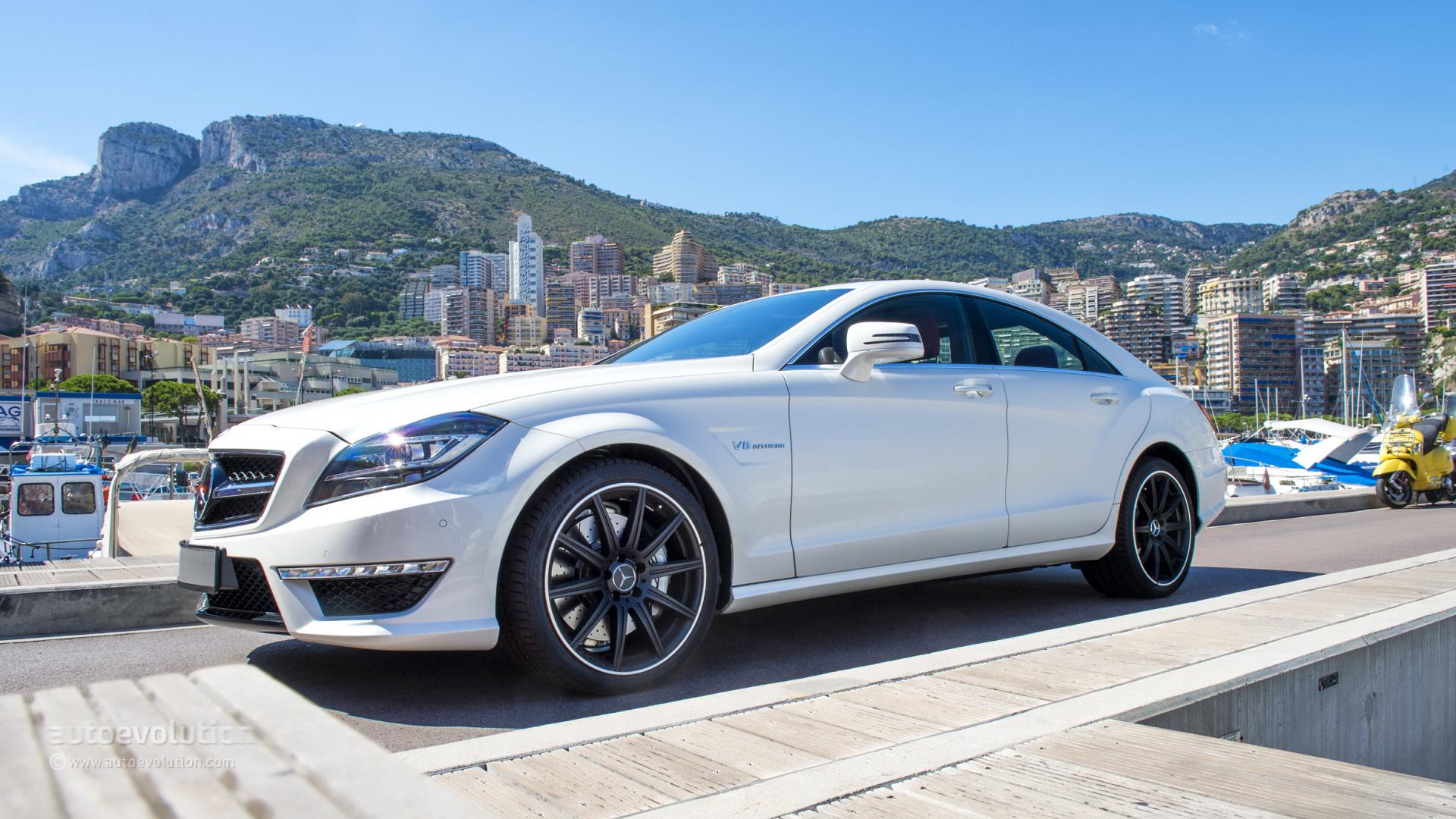 2014 mercedes benz cls63 amg 4matic review autoevolution for Mercedes benz cls63