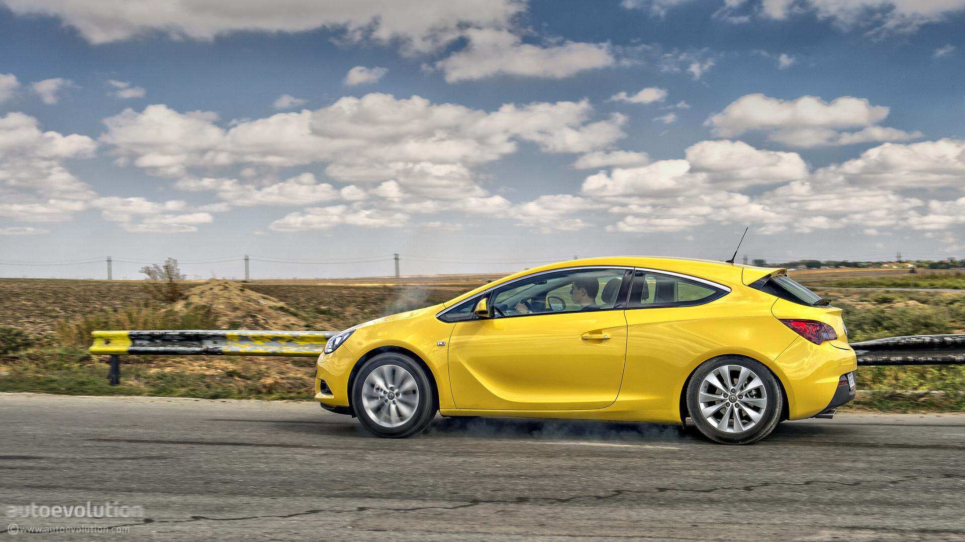 Opel Astra хетчбэк песок горы дорога онлайн